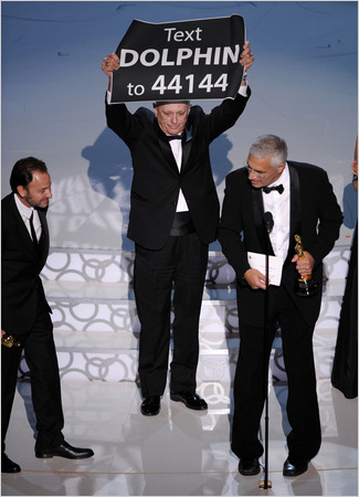 Louie-psihoyos-right-accepted-the-oscar-for-the-cove-on-sunday-with-ric-obarry-center-and-fisher-stevens